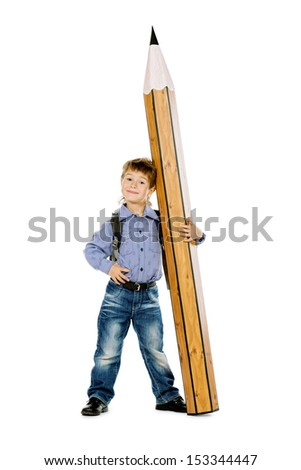 A boy standing with a huge pencil. Education. Isolated over white.
