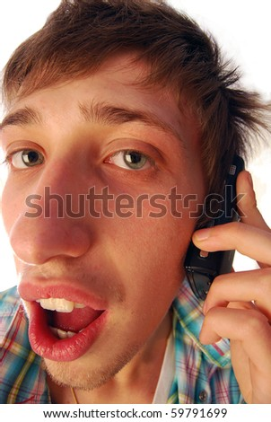 A boy to the phone while conversing