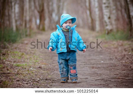 A boy toddler posing and modeling