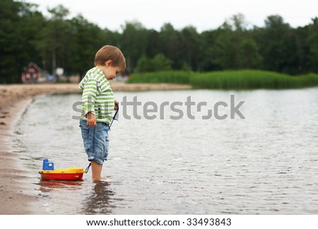 A boy with  a boat