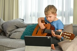 A boy with acuostic guitar