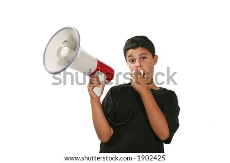 A boy yelling into a megaphone