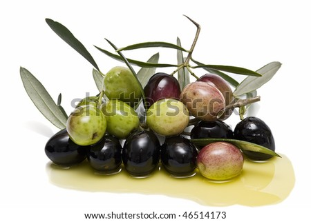 A branch with olives and leaves and some oil.