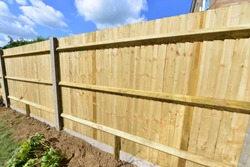 A brand new close boarded fence in the UK in September.