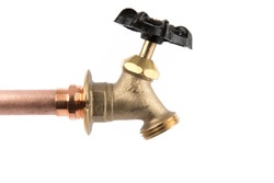 a brass plumbing tap with a hose thread attached to a copper tube