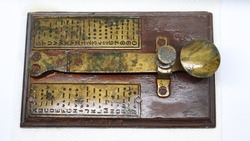 A brass telegram used for communications during second world war using Morse code encryption. Cryptography and message services.