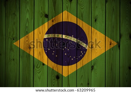 A Brazil flag painted on a wooden wall