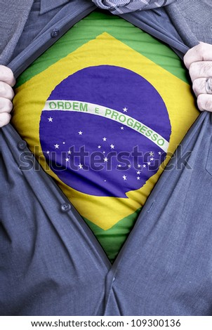 A Brazilian businessman rips open his shirt and shows how patriotic he is by revealing his countries flag beneath printed on a t-shirt