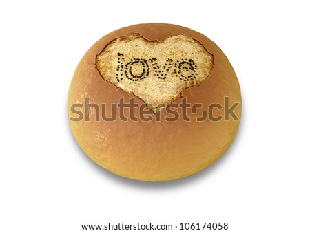 A bread bun with a heart-shaped hole etched out the top with the word love spelled out with poppy seeds