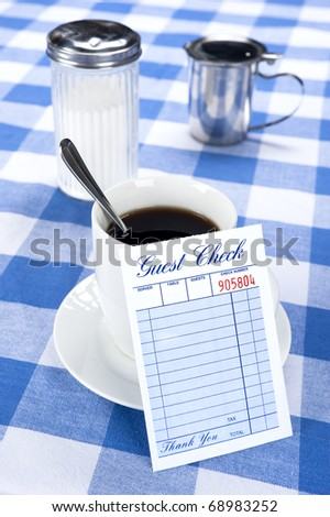 A breakfast and coffee setting in a cafe diner with a blank check for placement of copy.