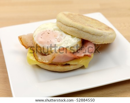 A breakfast bacon egg and cheese english muffin
