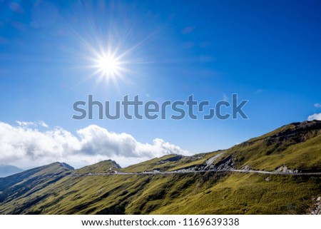 A breathtaking landscape in Taiwan. This was taken on top of a mountain. The clouds formation is vast and dramatic. The sun rises above the thick clouds. The image is calm, peaceful and magnificent. #1169639338