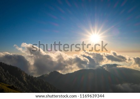 A breathtaking landscape in Taiwan. This was taken on top of a mountain. The clouds formation is vast and dramatic. The sun rises above the thick clouds. The image is calm, peaceful and magnificent. #1169639344