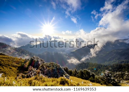 A breathtaking landscape in Taiwan. This was taken on top of a mountain. The clouds formation is vast and dramatic. The sun rises above the thick clouds. The image is calm, peaceful and magnificent. #1169639353