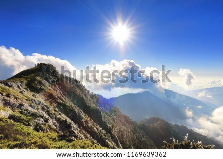 A breathtaking landscape in Taiwan. This was taken on top of a mountain. The clouds formation is vast and dramatic. The sun rises above the thick clouds. The image is calm, peaceful and magnificent. #1169639362