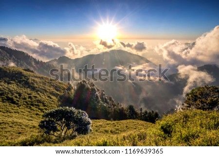 A breathtaking landscape in Taiwan. This was taken on top of a mountain. The clouds formation is vast and dramatic. The sun rises above the thick clouds. The image is calm, peaceful and magnificent. #1169639365