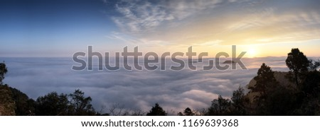 A breathtaking landscape in Taiwan. This was taken on top of a mountain. The clouds formation is vast and dramatic. The sun rises above the thick clouds. The image is calm, peaceful and magnificent. #1169639368