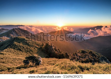 A breathtaking landscape in Taiwan. This was taken on top of a mountain. The clouds formation is vast and dramatic. The sun rises above the thick clouds. The image is calm, peaceful and magnificent. #1169639371