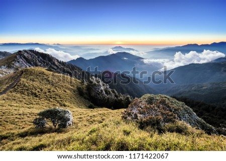A breathtaking landscape in Taiwan. This was taken on top of a mountain. The clouds formation is vast and dramatic. The sun rises above the thick clouds. The image is calm, peaceful and magnificent. #1171422067