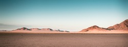 a breathtaking panoramic shot of desert plains in Namibia Africa with hills in the background