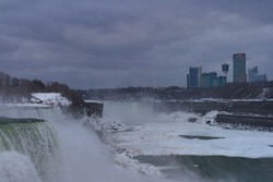 A breathtaking view of the famous Niagara Falls in Canada under a gloomy sky backgroundnd