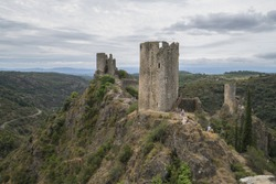 A breathtaking view of the Lastours Castels on the mountains captured in South of France