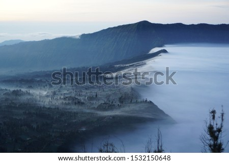 A breathtaking view when seeing beautiful morning light and the sea of fog at a small hamlet, Cemoro Lawang, Mount Bromo, East Java, Indonesia. Bromo is one of the best places to see sunrise in Asia.