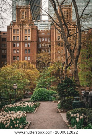 A brick building with a garden in front of it, Tudor City, New York, New York Stock fotó ©