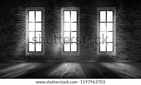 A brick wall in an empty room, large wooden windows, a magical light and the rays of the sun. #1197963703