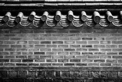 A brick wall of a Korean historical palace in black and white