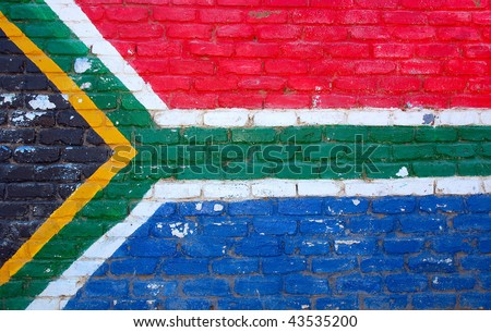 A brick wall painted with the colors of the national flag of South Africa