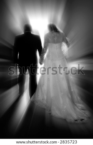 A bride & groom walk toward a new life together #1 (black & white, zoom special effect).