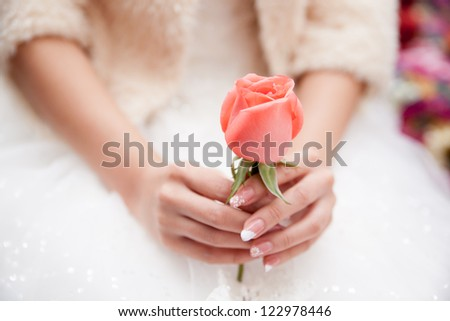 A bride, holding a rose