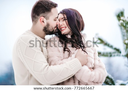 a bride in a fur coat with a fiance among the Carpathian mountains #772665667