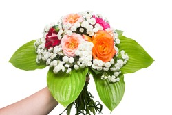 A bride's bouquet of beautiful roses and yarrow with hosta leaf in the girl hand. Flowers. Spring. Flat lay, top view. Love. Valentine's Day. Easter. Wedding card. Object