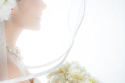 A bride smiling with a wedding veil