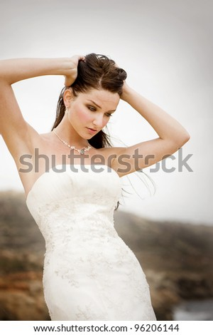 A bride standing on the coast and posing