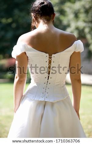 A bride walking in her dress, rear view
