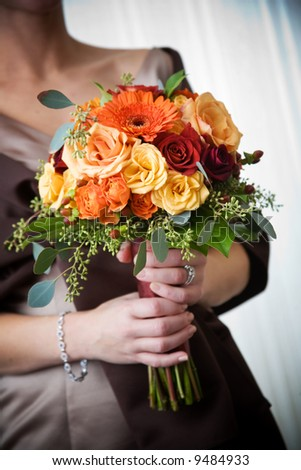 Bookey Flower http://www.shutterstock.co.in/pic-9484933/stock-photo-a-brides-wedding-bouquet-of-flowers-being-held-in-her-hands.html