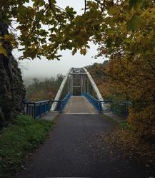 A bridge above Svratka river near Veveri castle, near Brno, Czech Republic. Symmetric lines of the bridge over the river.