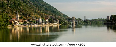 A bridge across the Rhone River and the commune of Andance, France