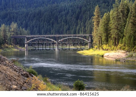 A bridge in the distance spans across the Flathead river in Montana.