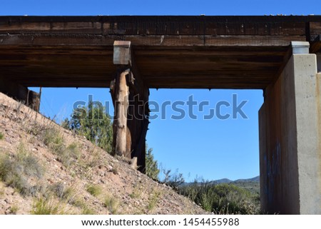 A bridge is a structure built to span a physical obstacle, such as a body of water, valley, or road, without closing the way underneath. It is constructed for the purpose of providing passage  #1454455988