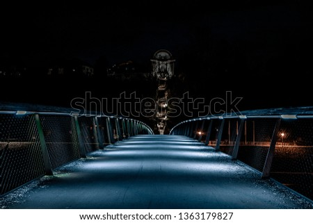 A bridge leading to a stairway leading to a chapel