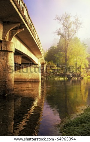 A Bridge lit by sunlight in a foggy morning near Yosemite National Park