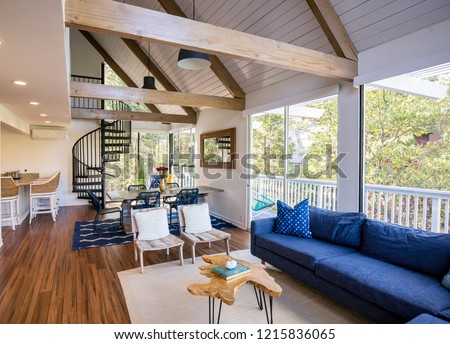 A bright a beautiful living room and kitchen. Farm house/modern interior design.