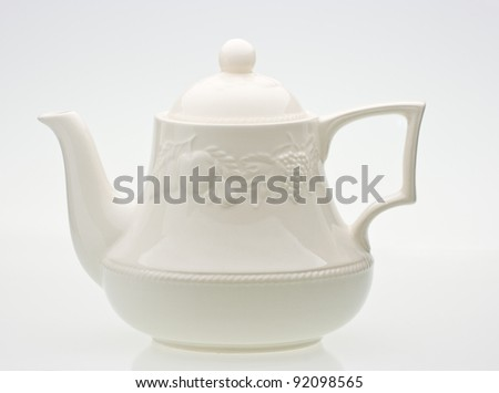 A bright cream ceramic standard design teapot isolated on white