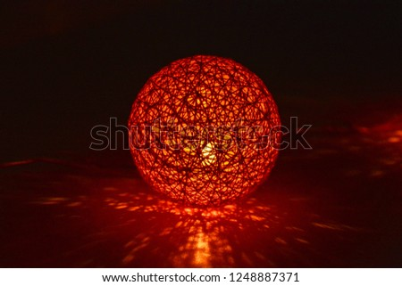 A bright glowing ball from Christmas garland glows in the dark #1248887371
