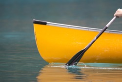A bright morning canoe trip begins.