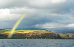 A bright rainbow over the little town of Waimea on the southern coast of Kauai